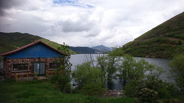 What appears to be a small lodge with the beautiful reservoir and hills behind