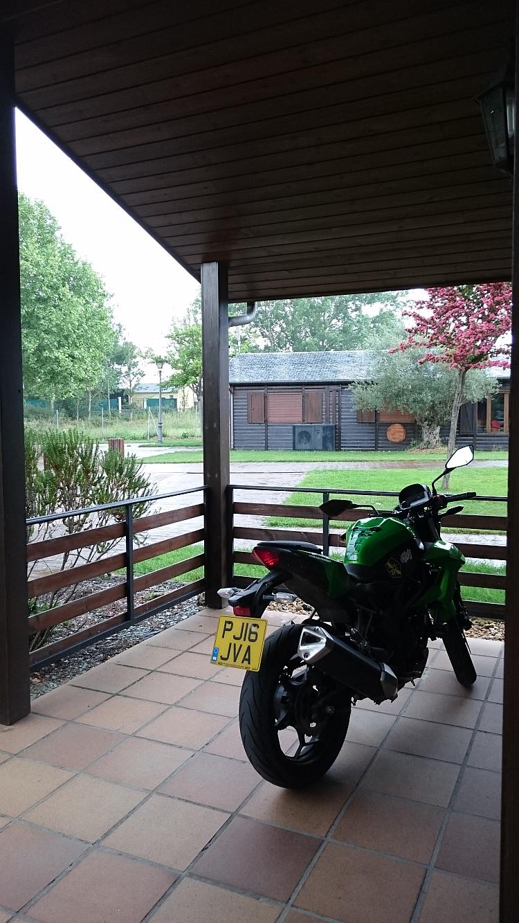 Sharon's 250 is dry under the veranda while the heavy rain soak outside