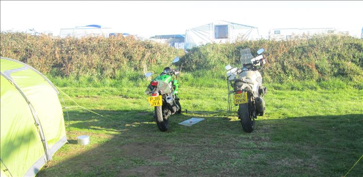 2 motorcycles and a tent in the low morning sun at Shell Island's campsite