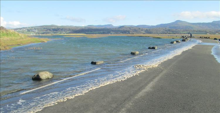 The sea water is just barely covering the edge of the road from the campsite to the mainland