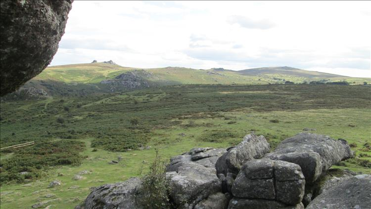 Looking out from the tor we see rolling hills with rocky outcrops stretching to the distance