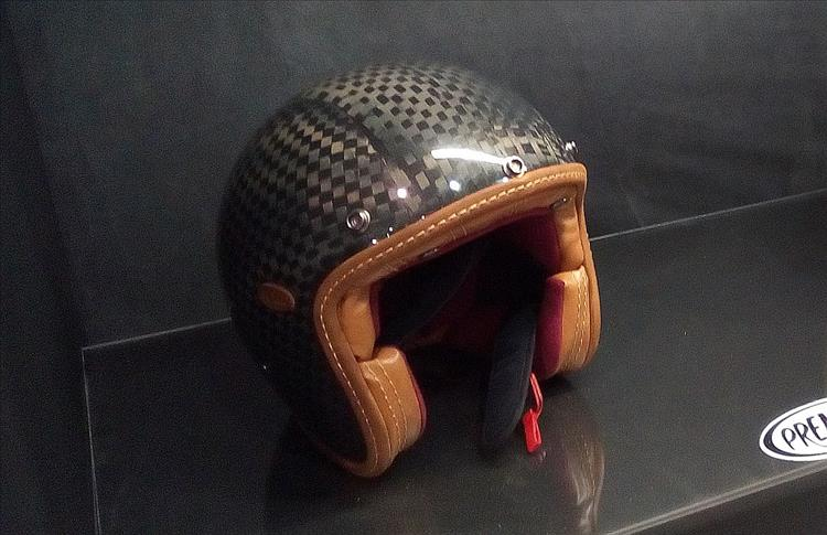 A carbon look helmet made in a traditional vintage style