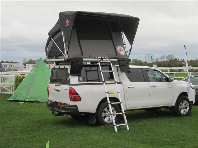 Toyota Hilux with roof tent, Ren's small teepee tent is hiding behind the adventure car