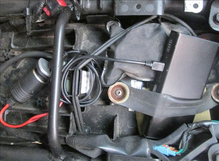 The 12v socket, the adaptor, the cable and the power bank under the seat