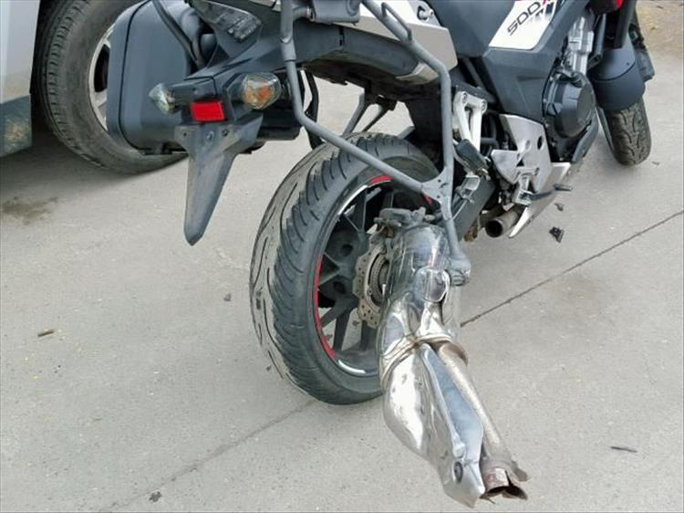 Pete's CB500X after the crash. Exhaust ripped off pannier missing