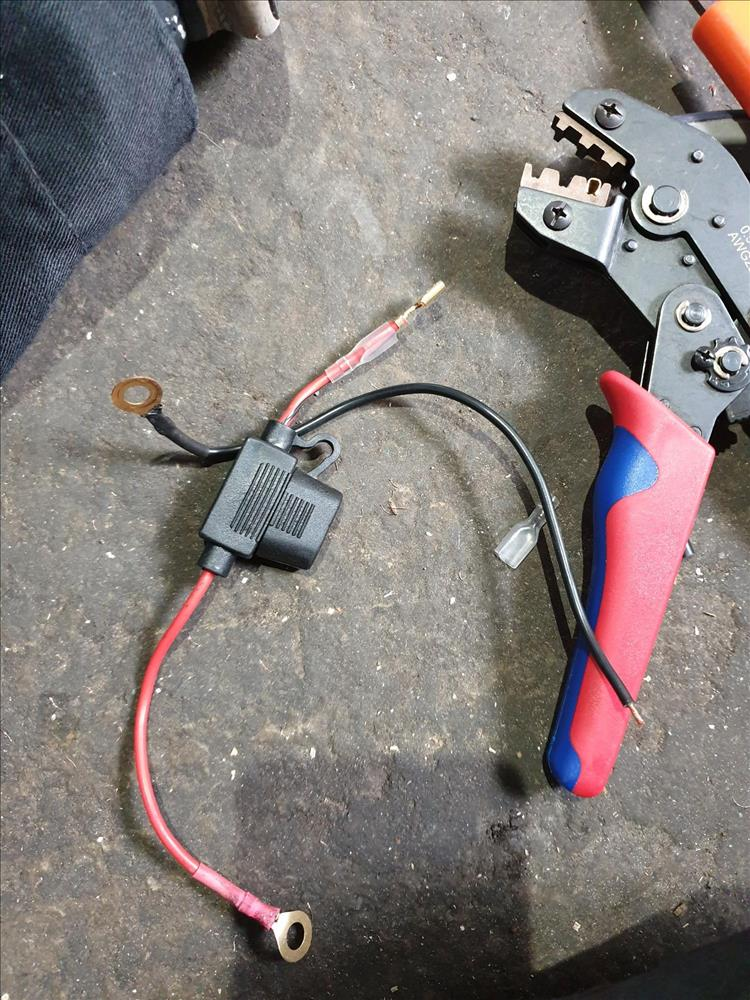 An electrical crimping tool and some associated wires on the floor of Pocketpete's garage