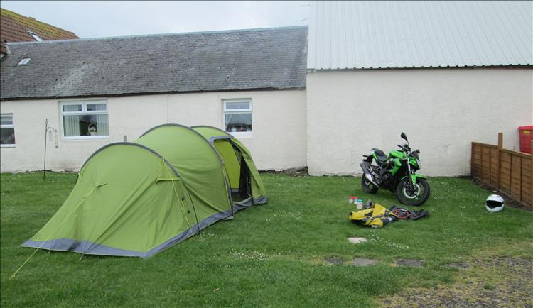 The tent next to a building at the Heads of Ayr Campsite