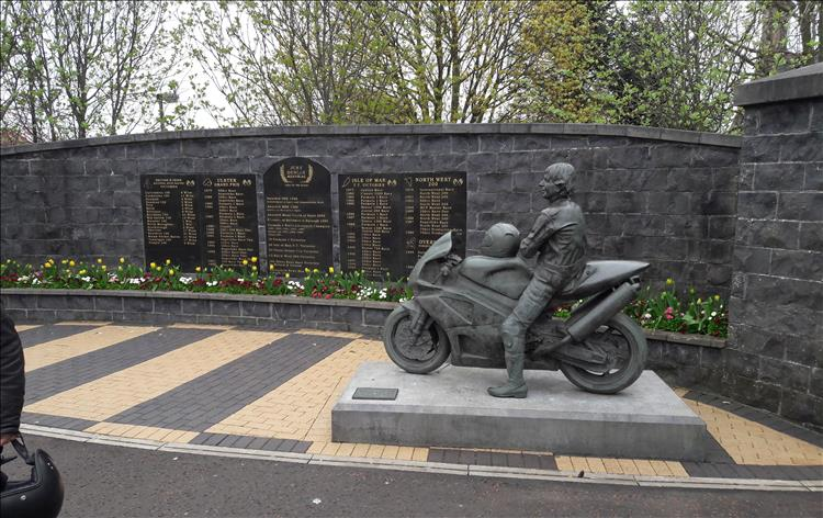 Joey Dunlop statue and a wall with records of his victories, the joey dunlop memorial