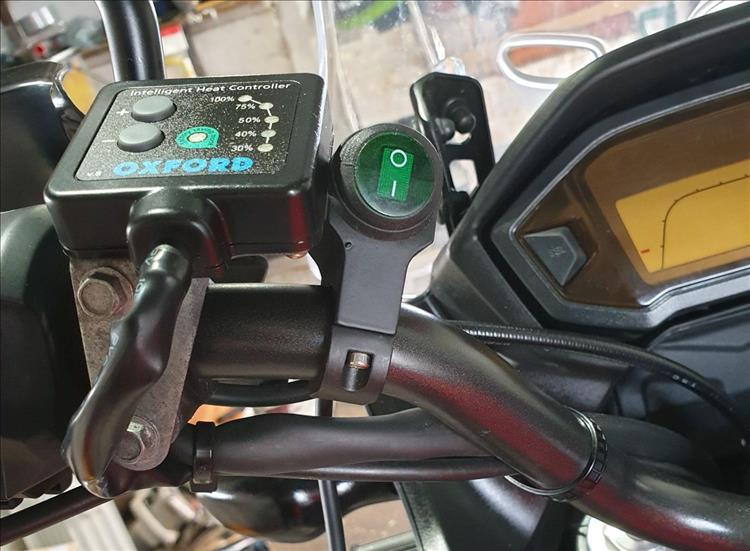 The switch is mounted on the bars next to the heated grips switches too