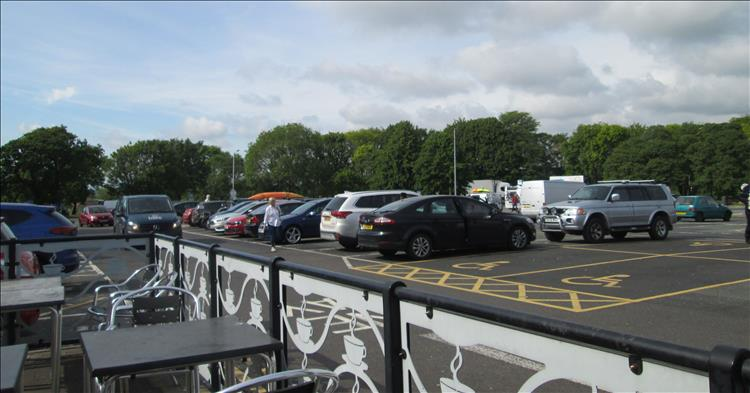 A car park and seating at the services on the M6