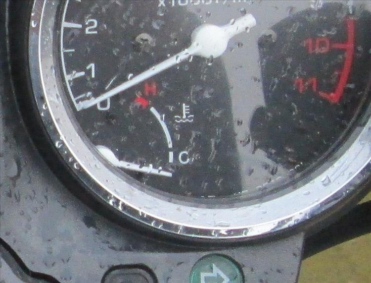 A fuel gauge on a motorcycle dashboard
