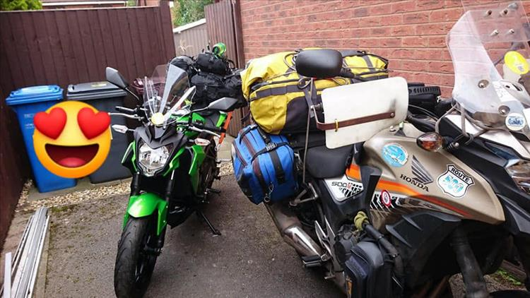 The 2 motorcycles covered in luggage ready to leave Sharon's house