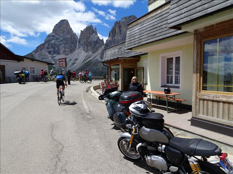 Motorcycles, towering rocky mountains, cyclists, a bar and Upt'North's wife in The Dolomites