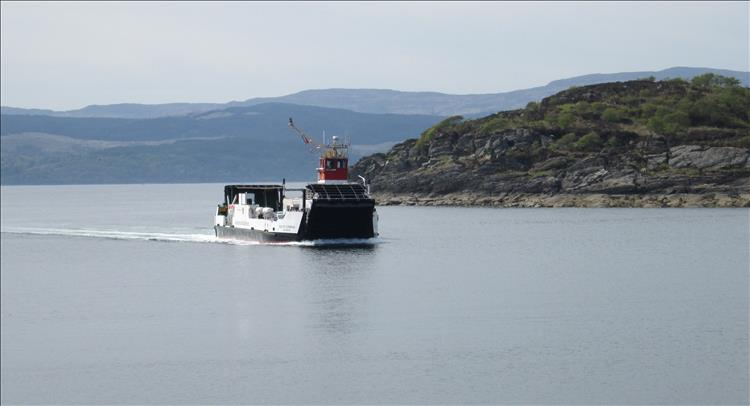 A small ferry on the incredibly calm waters of Loch Fyne