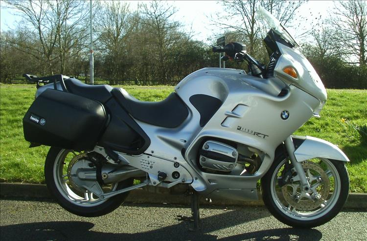 A used but clean and smart BMWR1150RT touring motorcycle, much much bigger than the 250