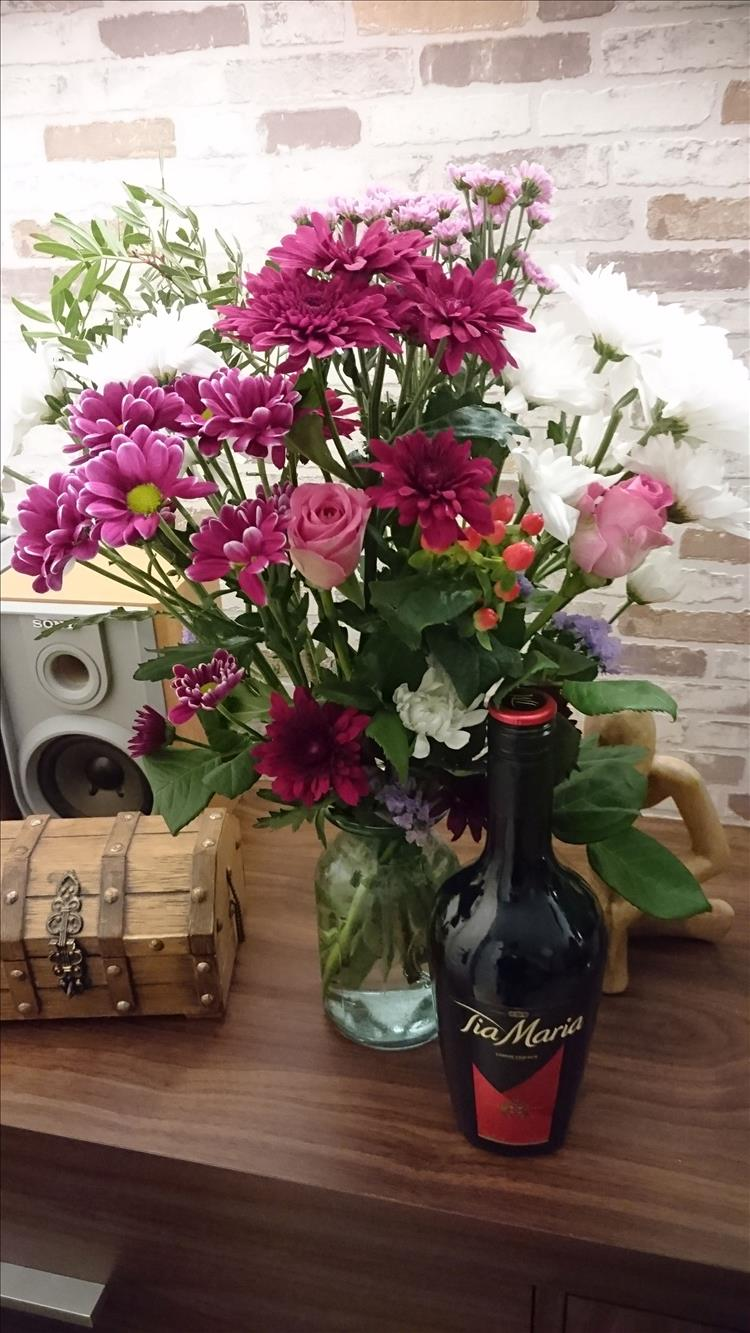 A bouquet of flowers and a bottle of tia maria from Sharon's daughter