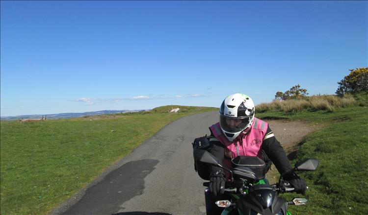 Sharon tentatively sits on the 250 on a narrow lane cresting the top of a steep hill