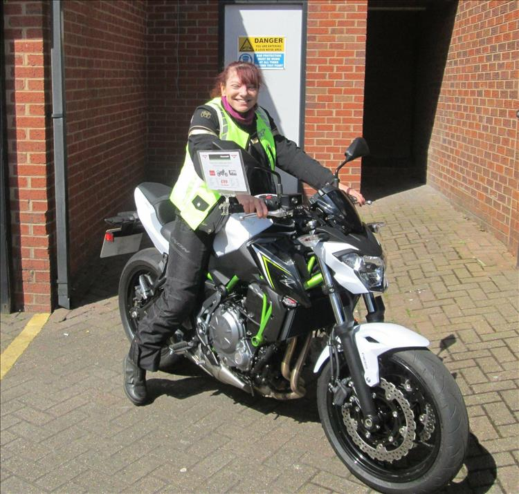 Sharon has a beaming smile sat on a white Kawasaki Z650
