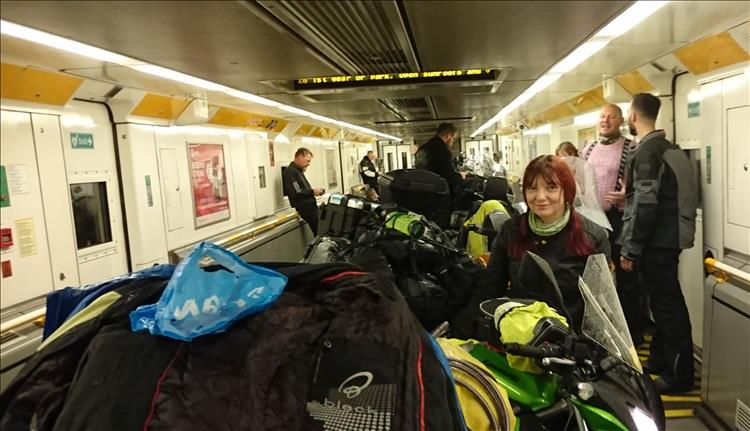 Sharon in the channel tunnel train with her motorcycle and several others as well