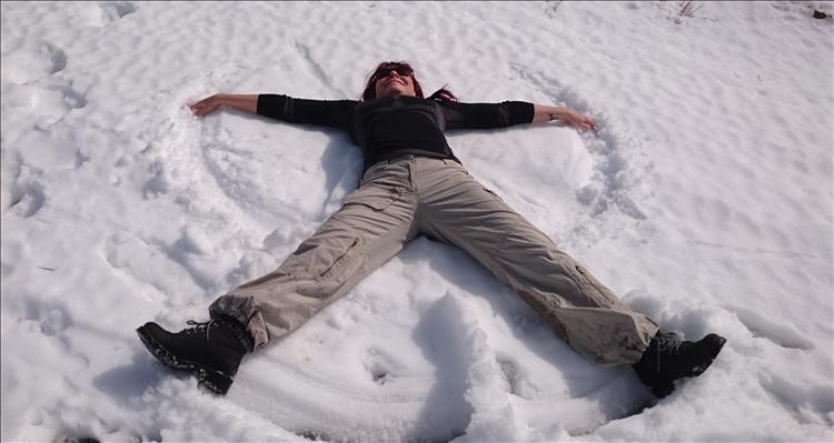 Sharon making snow angels on our walk into the Welsh mountains
