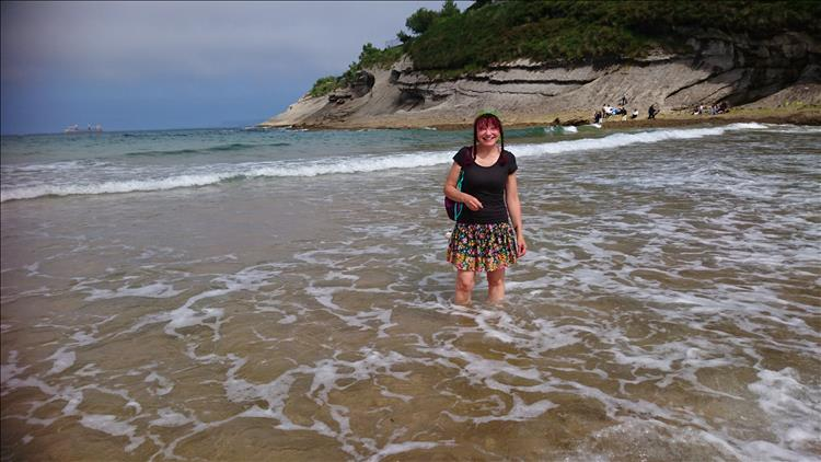 Sharon is paddling in the warm waters of the small cove