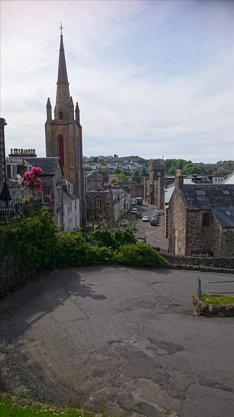 A tall church spire, a sharp corner and the steep hill of the serpentine road at Rothesay