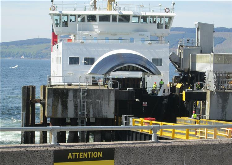 The ferry is port with the bow door open and offloading traffic