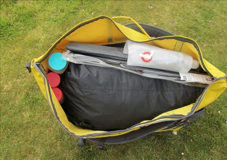The big tent bag in another bag with cartons of food and the poles etc
