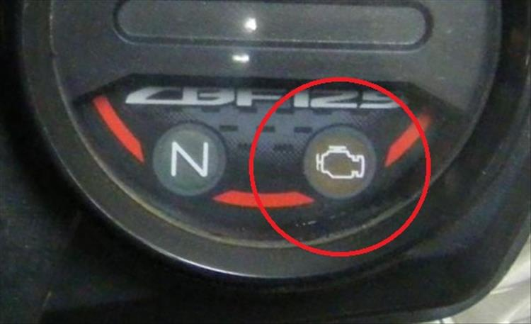 The EFI or engine management light circled in red