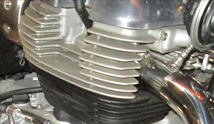 The cooling fins on a motorcycle engine