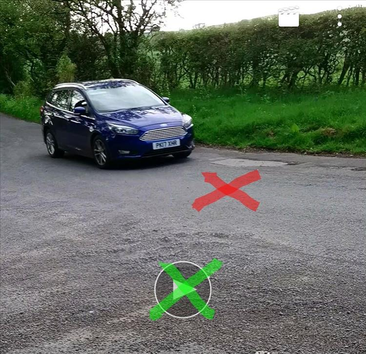"The country lane is narrow with red ""X""s to mark where Sharon and the car were"