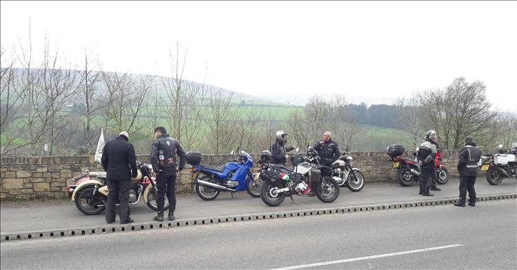 An exclectic collection of motorcycles stopped at the roadside on a ride through Northern Ireland's Sperrin Mountains