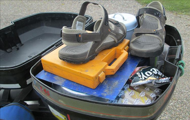 A top box full of sandals and many other things