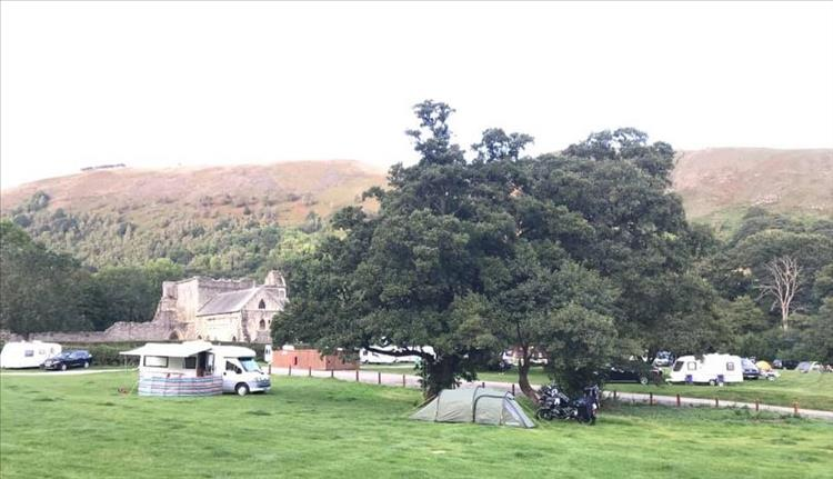 Abbey Farm Campsite with the abbey ruins in the background