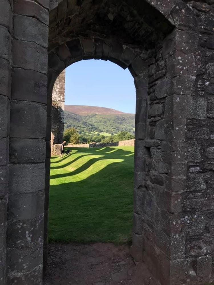 Looking through an old doorway out to the ruins and the beautiful welsh countryside