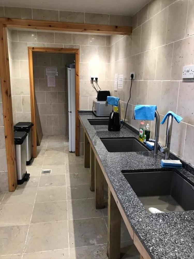 Smart clean tiles, wood trim, large sinks and a modern feel to the washing up area