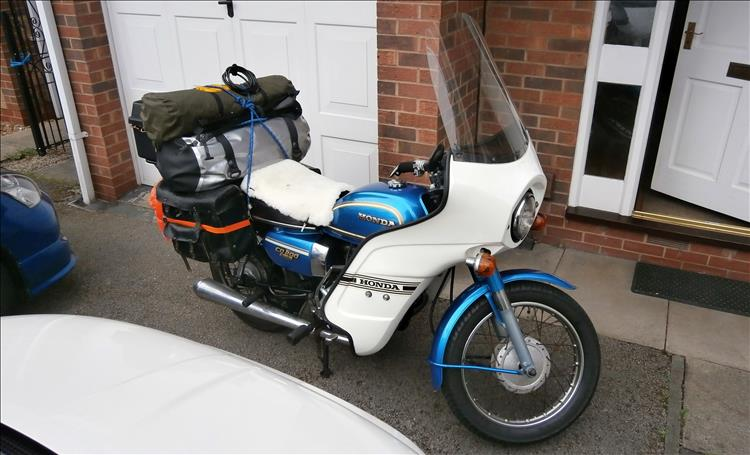 Boggers blue CD200 benly with white full fairing and camping kit