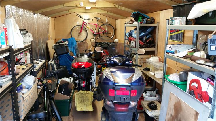 A shed filled with bikes, you have to guess which is which