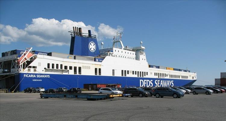 A blue and white ferry ready to sail back to the uk