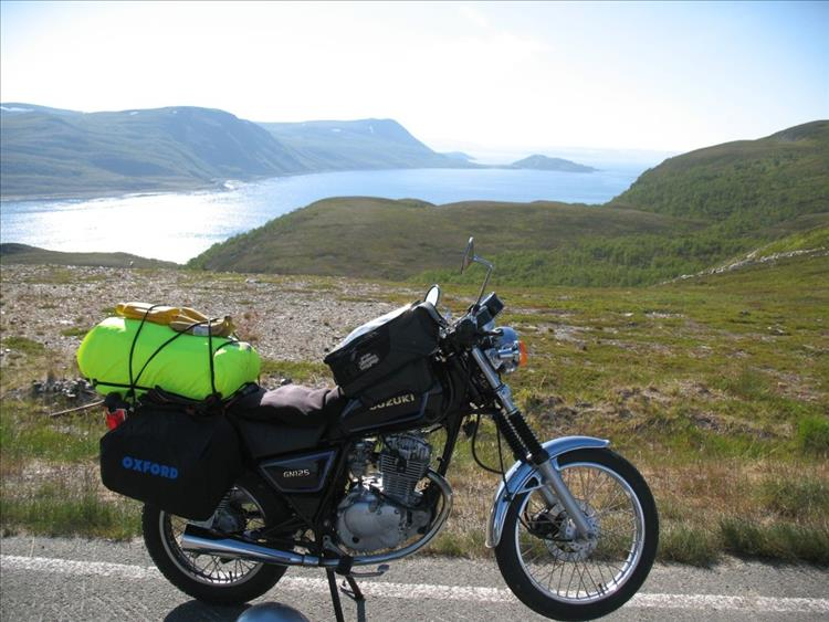 Amazing Scandinavian scenery and Marks GN125 with bananas strapped to the luggage