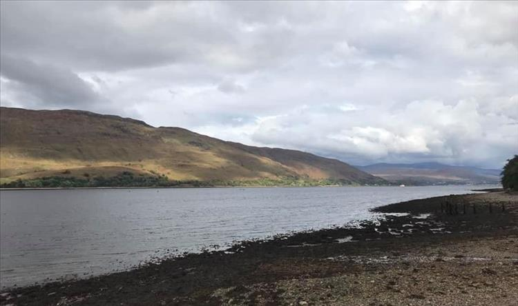 Loch Eil again this time from a pebble beach looking into grey skies over the hills