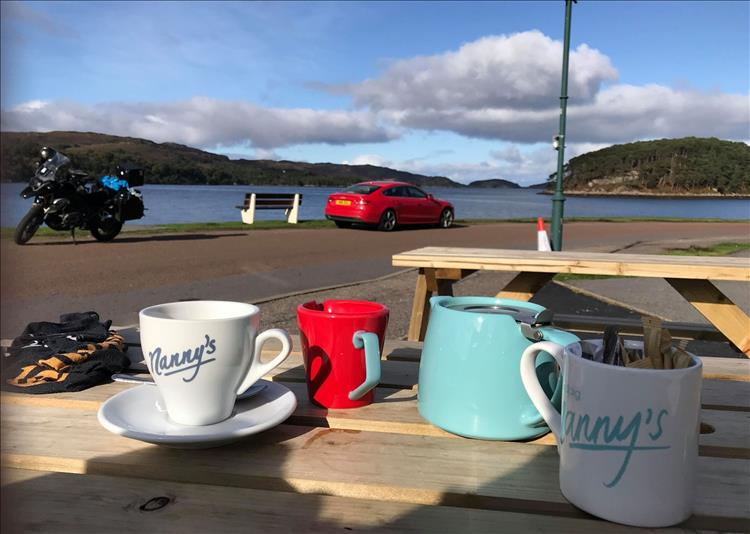 tea pot, cup, bench, andy's gs1200, the loch and the hills at the cafe