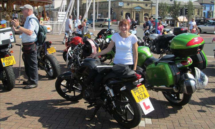 Sharon when she was a learner on her 125 smiling in the sun at Southport