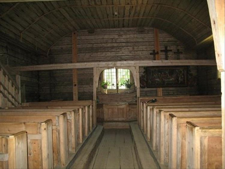 A small all wooden church, very simple and tightly packed with pews