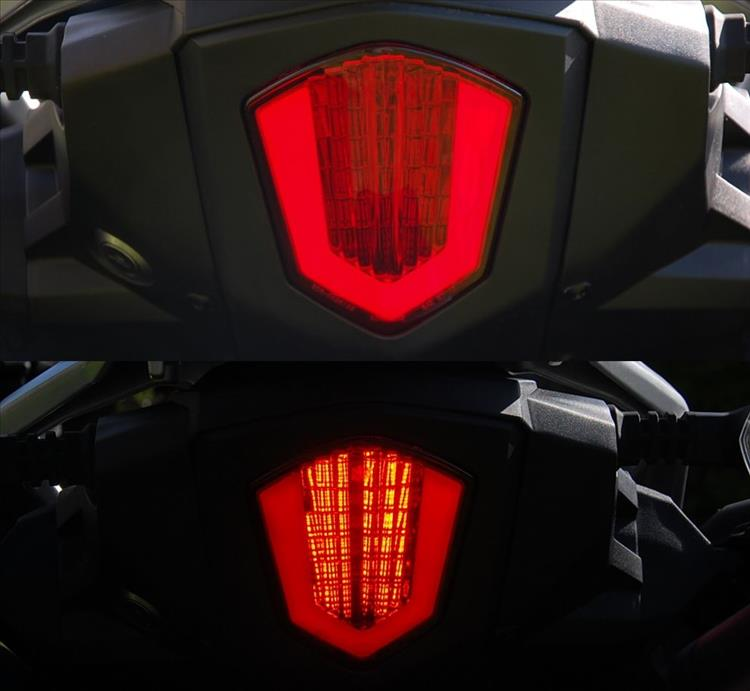 The rear light both unlit and lit on the 250 adventure bike