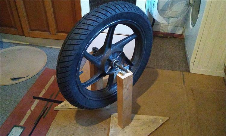 The rear wheel is in the home made wheel balancer in Ren's kitchen