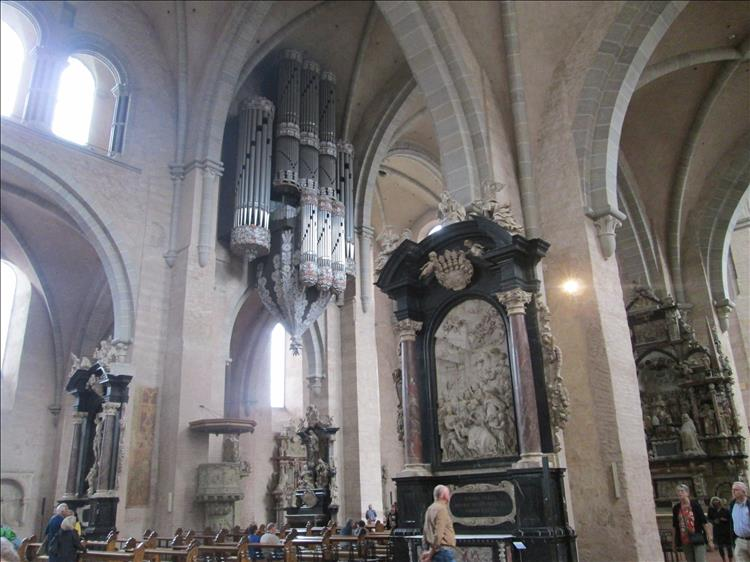 Massive pipe organ as well as sculptures, carvings and ornate masonry inside the large church
