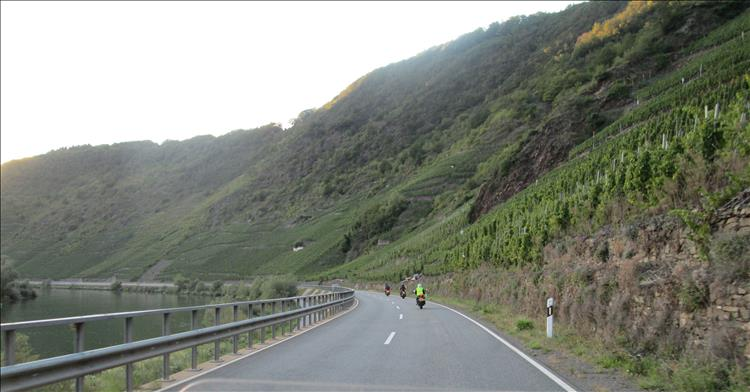 Steep valley sides, the road and the river. On the steep sides are vineyards along the moselle