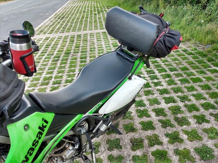 The KLX250 has a wider saddle and a padded backrest for long distance trips