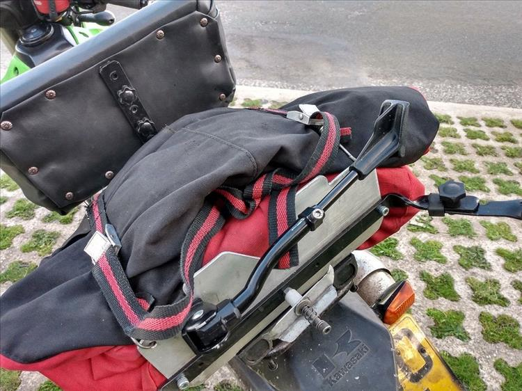 The backrest, the bags and the frame seen close from the rear of the motorcycle